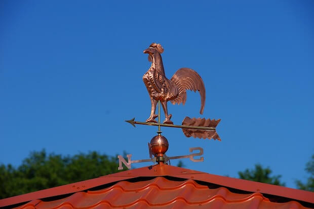 copper hen on roof