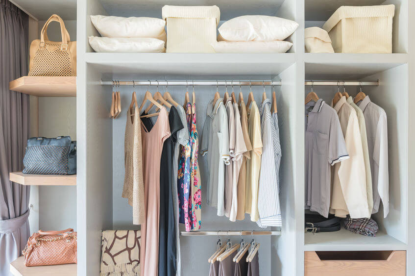 cloths and other items arranged in cabinets