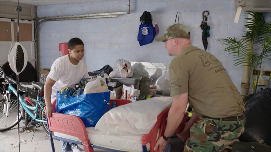 Army man giving furniture to a child
